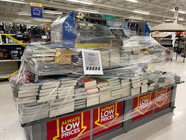 Photographs of closed-off items in Walmart