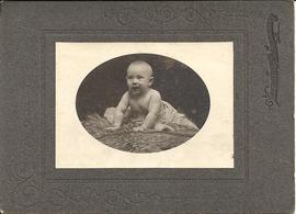 Photograph of baby on fur
