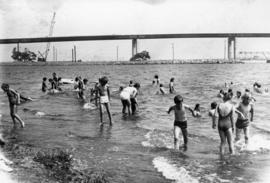 Children playing in water with Norris Whitney Bridge in background