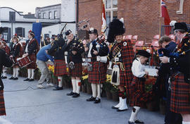 People with bagpipes preparing to play at the re-opening of city hall, in Belleville, Onatrio.