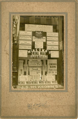 Mounted photograph of window display of John S. McKeown's Rexall drugstore at 271 Front Street, B...