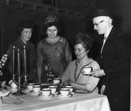 Charlotte Kurlter pouring tea for a group of women in Belleville, Ontario.