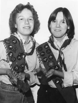 Two girls showing their blue Badge Sash, in Belleville, Ontario.