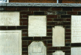 Old burial stones on wall of St. Thomas Church